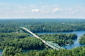 trucks cross the Thosand Islands Bridge which connects Ontario, Canada and New York State, USA