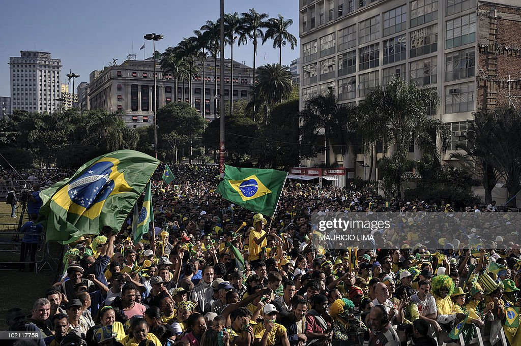 Thousand of Brazilian football fans gather at Anhangabau valley, in downtown Sao Paulo, Brazil, on June 15, 2010, to watch on a giant screen the FIFA World Cup South Africa 2010 Group G match between Brazil and North Korea. AFP PHOTO/Mauricio LIMA