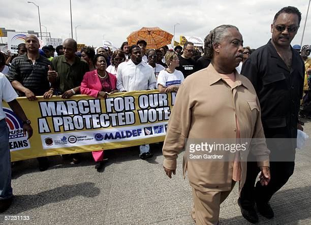 Thousand of demonstrators lead by Rev Jesse Jackson and Rev Al Sharpton cross the Mississippi River Bridge April 1 2006 in New Orleans Louisiana...