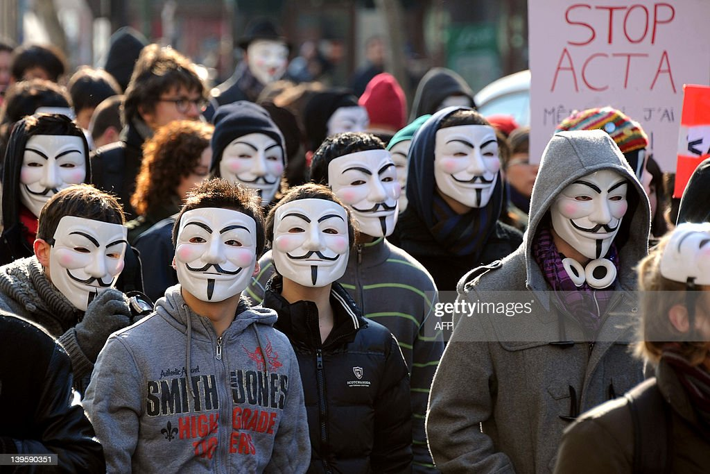 Thousand of demonstrators wearing Anonymous Guy Fawkes masks shout slogans during a protest against the Anti-Counterfeiting Trade Agreement (ACTA) on February 11, 2012 in Paris. Protesters have adopted as their own the now-iconic wryly smiling, mustachioed Guy Fawkes cartoon character masks of the global hacker group Anonymous. ACTA's aim is to beef up international standards for intellectual property protection, for example by doing more to fight counterfeit medicine and other goods. But it is ACTA's potential role in cyberspace that has caused outcry online and on the streets.