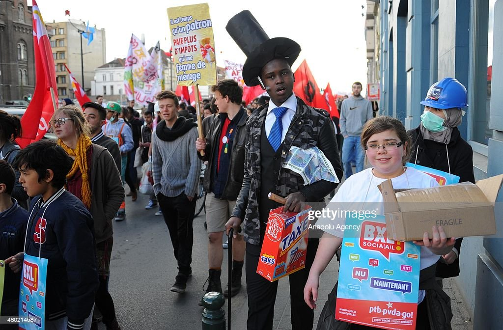 Thousand of people attend a demonstration of 'Social Plan Walk' to protest the government's fiscal austerity policy on March 23, 2014 in Brussels, Belgium. People wear unusual costumes during the demonstration.