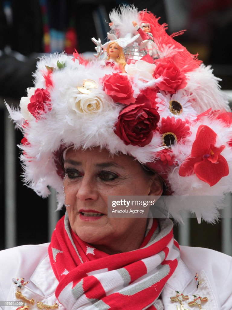 Thousand of people attend one of the biggest festivals 'Rose Monday carnival' in Cologne, Germany on March 3, 2014. People dressed up colorful and interesting costumes, try to grab candies threw from cortege. 350 horsemen, 117 bands and nearly 10,000 people walk 6,5 km way in six hours. Attendants in the parade deliver candies, chocolate, gums, flowers, toys and other presents to the people. Streets are showered with confetti rain during the carnival.