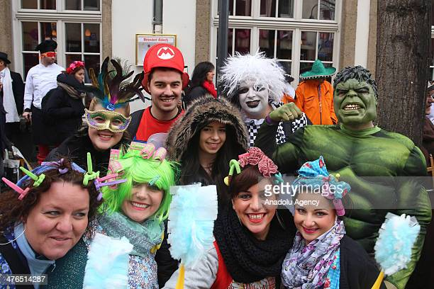 Thousand of people attend one of the biggest festivals 'Rose Monday carnival' in Cologne Germany on March 3 2014 People dressed up colorful and...
