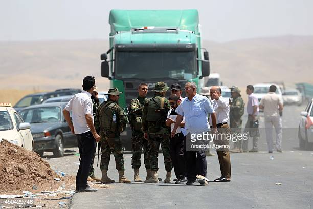 Thousands flee Iraq's Mosul due to the clashes between security forces and militants of Islamic State of Iraq and the Levant in Arbil Iraq on June 11...