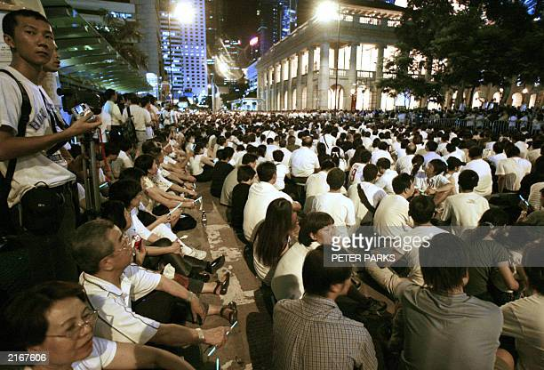 Thousands gather against the controversial Article 23 law outside Hong Kong's Legistlative Council building 09 July 2003 Thousands of Hong Kong...