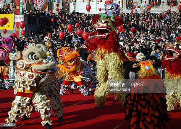 Thousands gather in London's Trafalgar Square to celebrate the Chinese New Year of the Monkey as they watch a lion dance 25 January 2004 AFP...