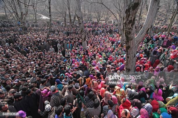 Thousands gather near the corspe of top rebel commanderAqib Ahmad Bhat alias Aqib Molvi during his funeral ceremony in south Kashmir's Hyuna village...