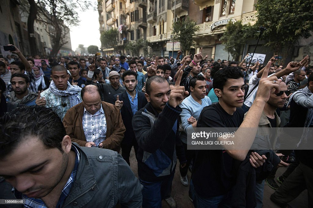 Thousands of activists and friends attend the funeral of Gaber Salah, an activist who died overnight after he was critically injured in clashes near Cairo's Tahrir Square last week, during his funeral procession in Tahrir Square, on November 26, 2012, in Cairo. Salah, a member of the April 6 movement known by his nickname 'Jika', was hurt in confrontations between police and protesters on Mohammed Mahmud street where protesters had been marking the first anniversary of deadly clashes.