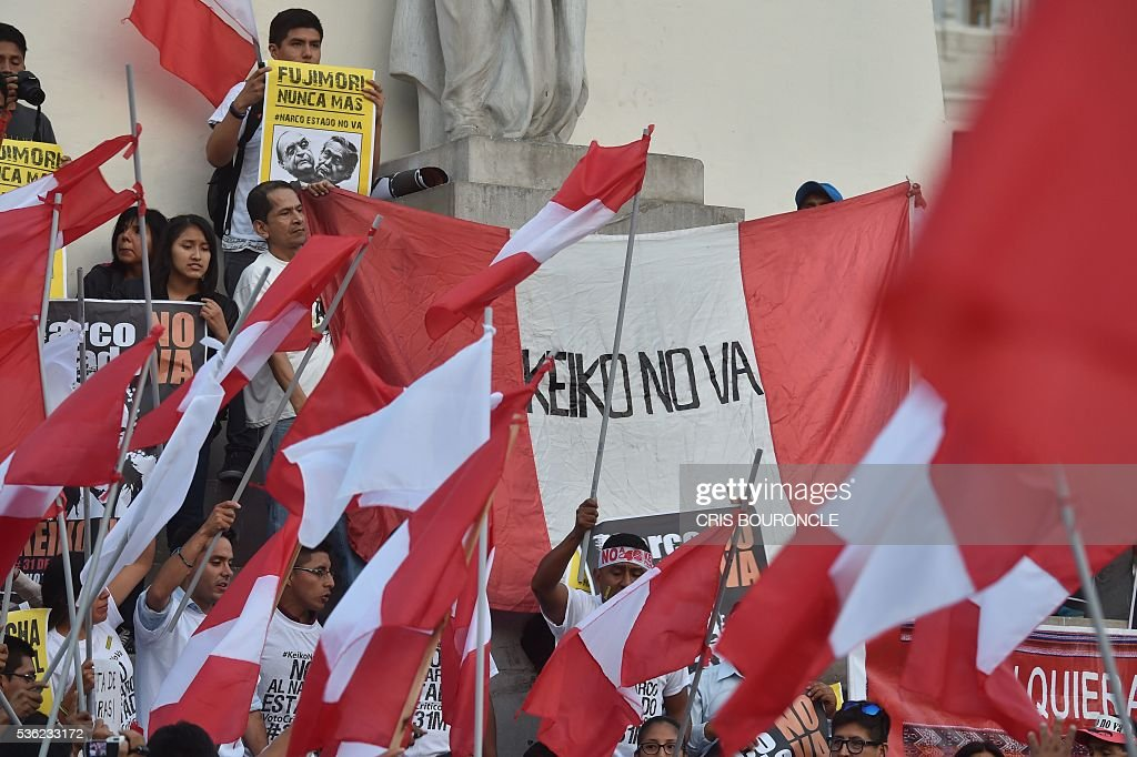 Thousands of activists gather to rally and march in Lima on May 31, 2016, opposing the candidacy of Keiko Fujimori, of the Fuerza Popular (Popular Strength) party, to the Peruvian presidency in the upcoming June 5 runoff election. Fujimori, daughter of former President Alberto Fujimori (1990-2000), imprisoned on corruption and crimes against humanity charges, faces Pedro Pablo Kuczynski, candidate of the 'Peruanos por el Kambio' (Peruvians for Change) party. Corruption allegations to members of the Fujimori inner circle taint Fujimoris campaign who continues to lead the polls with more than 45 percent of the voting intention. / AFP / CRIS