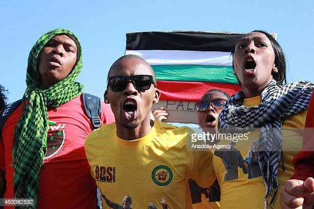 Thousands of Africans take streets to protest against the ongoing Israeli assaults on Gaza in the capital Cape Town on August 9 2014 Demonstrators...