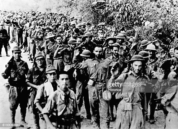 Thousands of American prisoners are forcemarched 55 miles from Bataan to a train that would take them to internment camps in the Philippines Some...