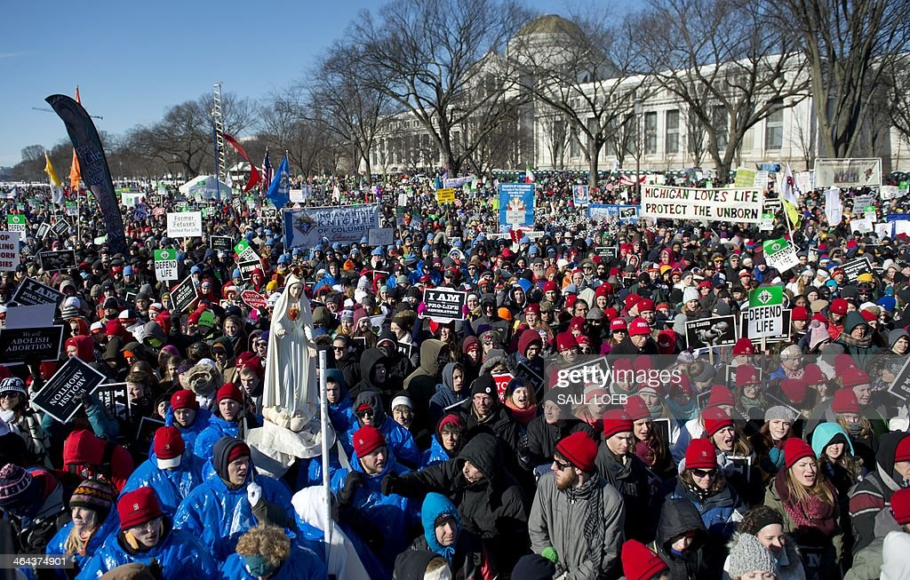 Thousands of anti-abortion demonstrators attend a rally on the National Mall during the 41st annual March of Life in Washington, DC, January 22, 2014. Held around the anniversary of the Supreme Court's Roe v. Wade decision, the march draws thousands from around the country for a rally on the National Mall before marching up Capitol Hill to the US Supreme Court. AFP PHOTO / Saul LOEB