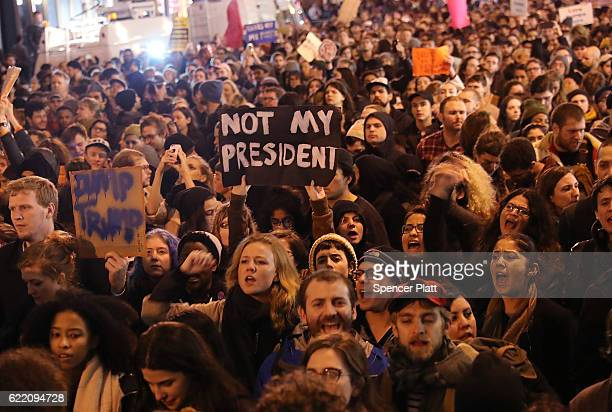 Thousands of antiDonald Trump protesters shut down 5th Avenue in front of Trump Tower as New Yorkers react to the election of Trump as president of...
