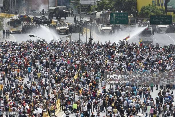 Thousands of antigovernment protestors block the Francisco Fajardo highway during a demonstration against the government of Nicolas Maduro on May 31...