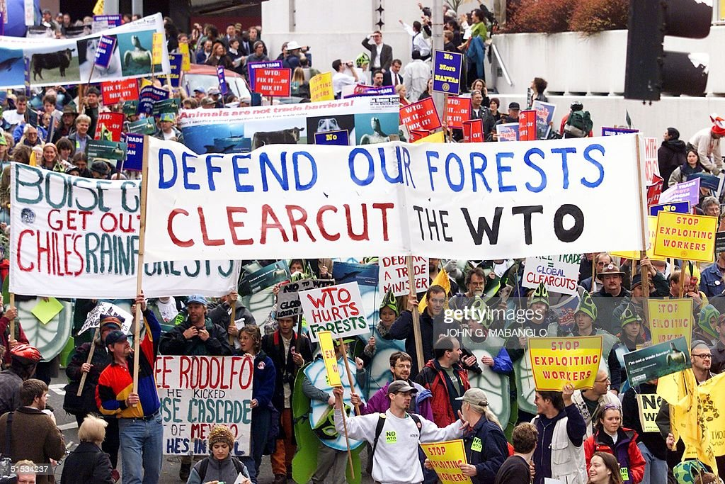 Thousands of antiWorld Trade Organziation protestors' march down Sixth Avenue in downtown Seattle Washington 29 November 1999 Many more activist are...