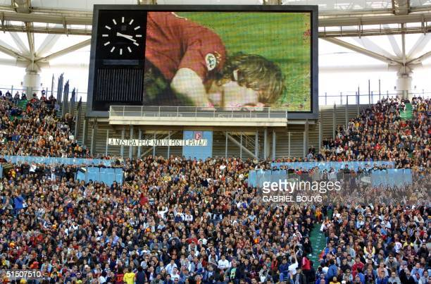 Thousands of AS Roma's fans look at AS Roma's captain Frenaceso Totti during the Italian league match Fiorentina Roma on a giant screen of the Rome's...