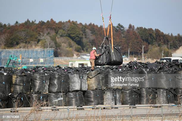 Thousands of bags of radiation contaminated soil and debris wait to be processed inside the exclusion zone close to the devastated Fukushima nuclear...