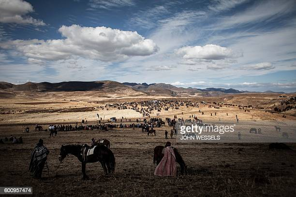 Thousands of Basotho Shepherds gather to watch and attend a horse racing competition on July 16 2016 in Semonkong Horseracing in the mountain kingdom...