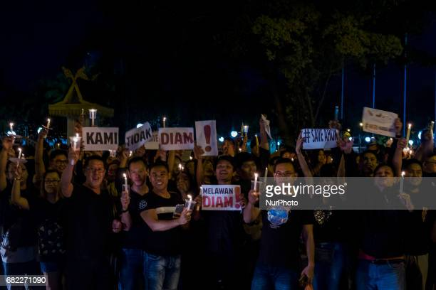 Thousands of Basuki Tjahaja Purnama known by his nickname Ahok hold candles to give their support for freedom from the accused of blasphemy in...