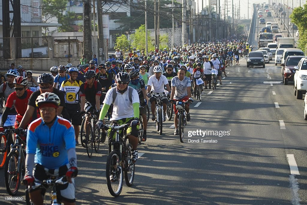 Thousands of bikers ride in the streets during the annual Tour of the Fireflies cycling event on November 18, 2012 in Manila, Philippines. The annual event organized by the Firefly Brigade, a cycling group of environmentalists, aims to promote cycling as a sustainable form of transportation in Metro Manila and has become a rite of passage for a growing number of weekend cyclists from all walks of life.