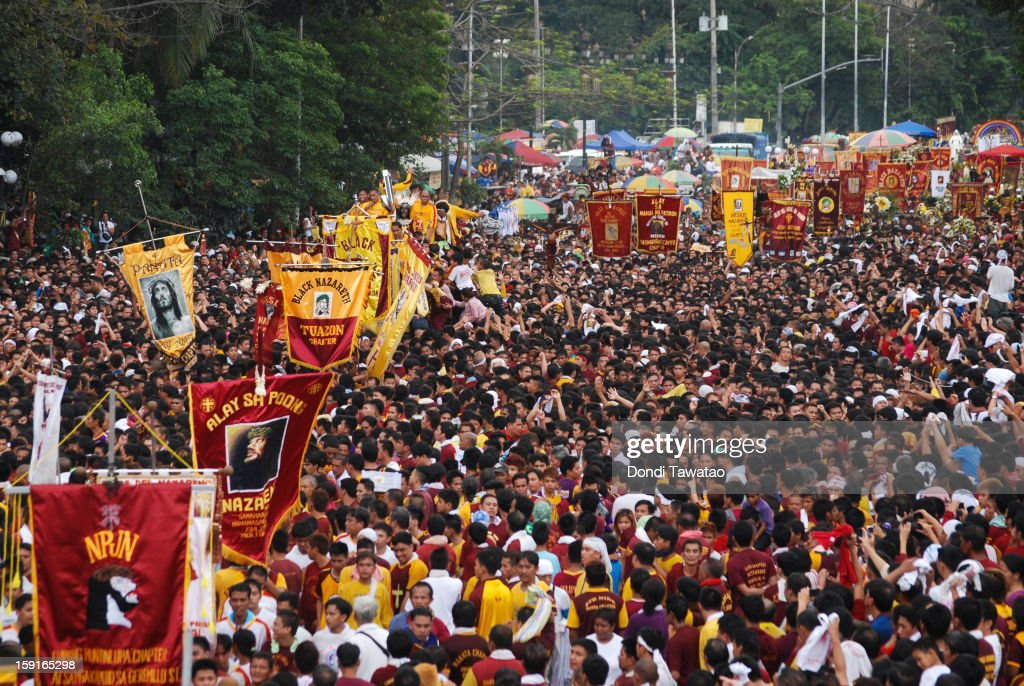 Thousands of Black Nazarene devotees try to climb on the carriage carrying the Black Nazarene during the procession of the 406th feast of The Black Nazarene on January 9, 2013 in Manila, Philippines. Devotees march barefoot as a sign of sacrifice during the procession as the Black Nazarene is carried in turn through Manila's thouroughfares. The dark wood sculpture of Jesus was brought to the Philippines in the 1600s by Spanish missionaries from Mexico to the philippines and is revered by Catholic devotees who claim the statue possess miraculous powers. Security authorities monitoring the day long procession estimated the crowd at around 2 million people at its peak.
