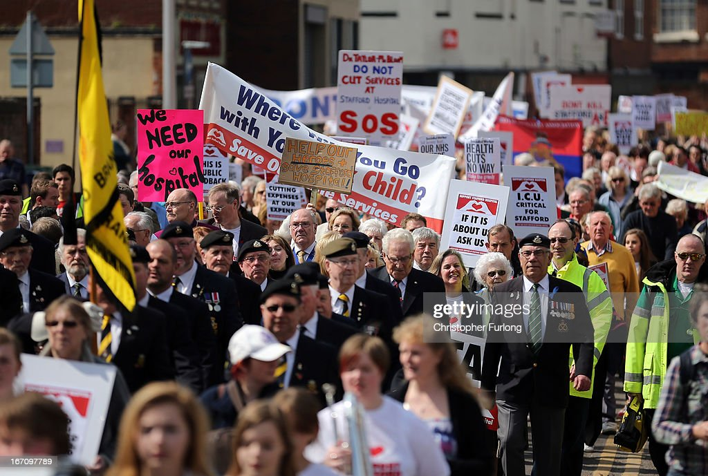 Thousands of campaigners take to the streets of Stafford holding signs as they demonstrate to keep major health services at the scandal hit Stafford Hospital on April 20, 2013 in Stafford, England. The march was organised by the Support Stafford Hospital campaign group who are fighting cuts to major health services at the hospital. The Health regulator monitor has appointed two special administrators to produce a plan for the reorganisation of future services.