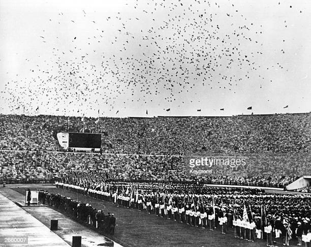 Thousands of carrier pigeons flying over the Olympic stadium in Helsinki They were released during the opening ceremony to convey the news of the...