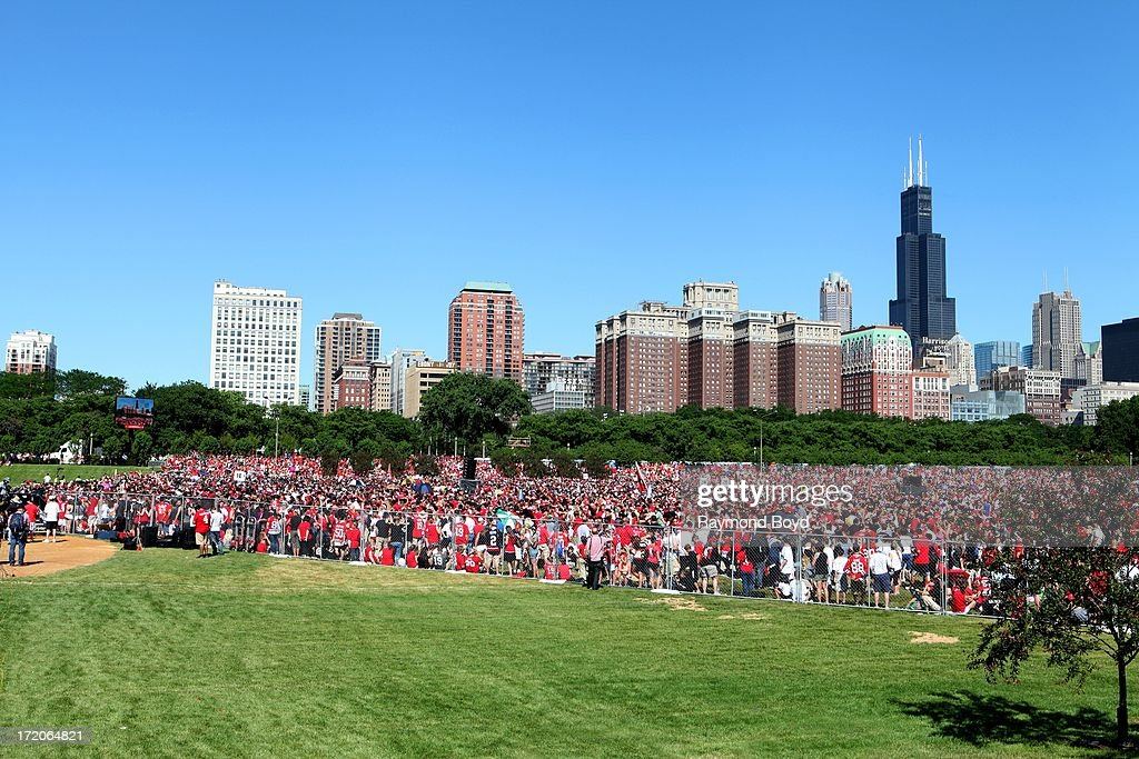 Thousands of Chicago Blackhawks fans prepare for the Chicago Blackhawks' 2013 Stanley Cup Championship rally at Hutchinson Field in Grant Park in Chicago, Illinois on JUNE 28, 2013.