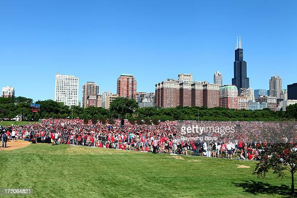 Thousands of Chicago Blackhawks fans prepare for the Chicago Blackhawks' 2013 Stanley Cup Championship rally at Hutchinson Field in Grant Park in...
