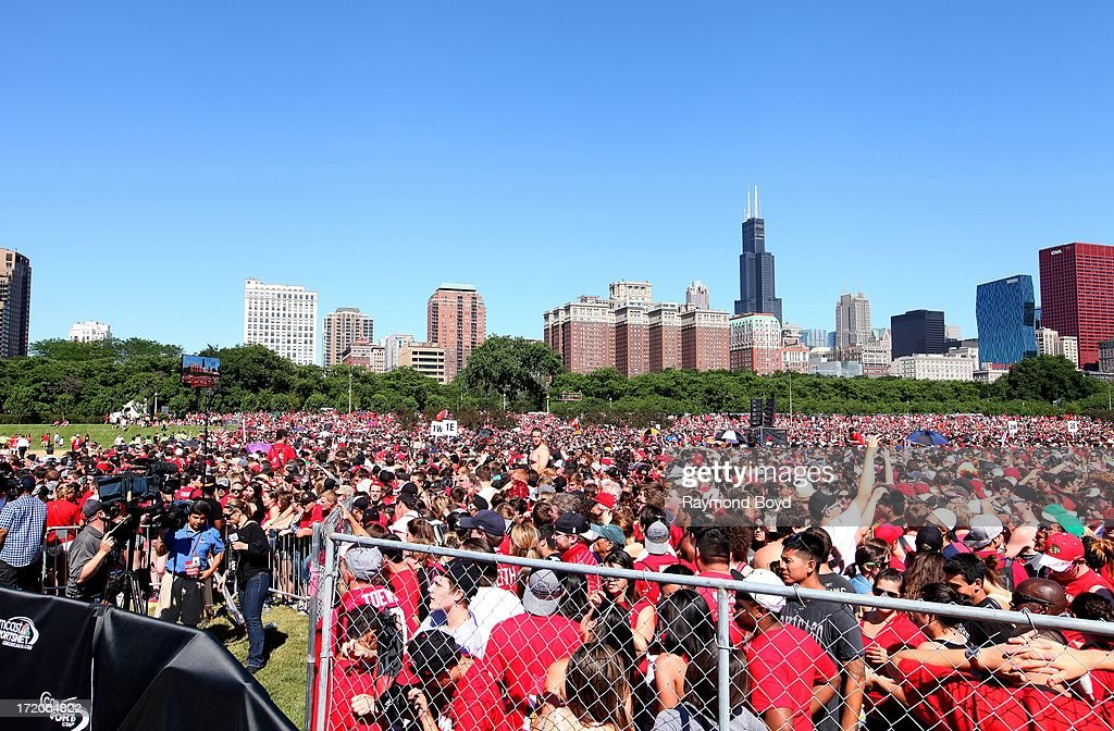 Thousands of Chicago Blackhawks fans prepare for the Chicago Blackhawks' 2013 Stanley Cup Championship rally at Hutchinson Field in Grant Park in Chicago, Illinois on JUNE