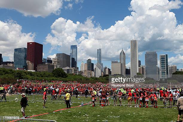 Thousands of Chicago Blackhawks fans prepare to leave at the conclusion of the Chicago Blackhawks' 2013 Stanley Cup Championship rally at Hutchinson...