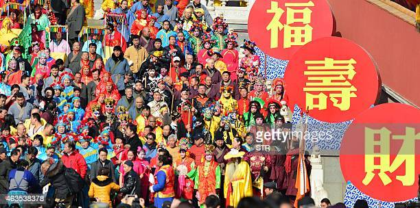 Thousands of Chinese devotees gather to welcome the various deities at the Badachu temple in Beijing on February 16 2015 for the upcoming Lunar New...