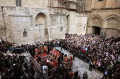 Thousands of Christian Orthodox worshippers attend the Washing of the Feet Easter ceremony lead by Greek Orthodox Patriarch of Jerusalem Theophilos...