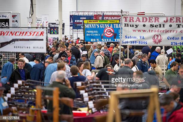 Thousands of customers and hundreds of dealers sell show and buy guns and other items during The Nation's Gun Show at the Dulles Expo Center which is...