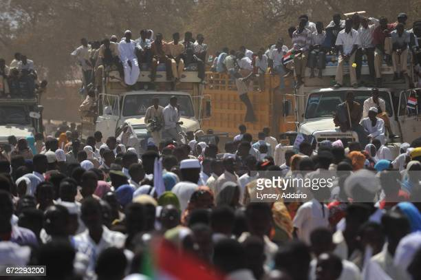 Thousands of Darfurians attend a rally as Sudanese President Omar Al Bashir speaks in El Fasher in North Darfur Sudan March 8 2009 Bashir continues...