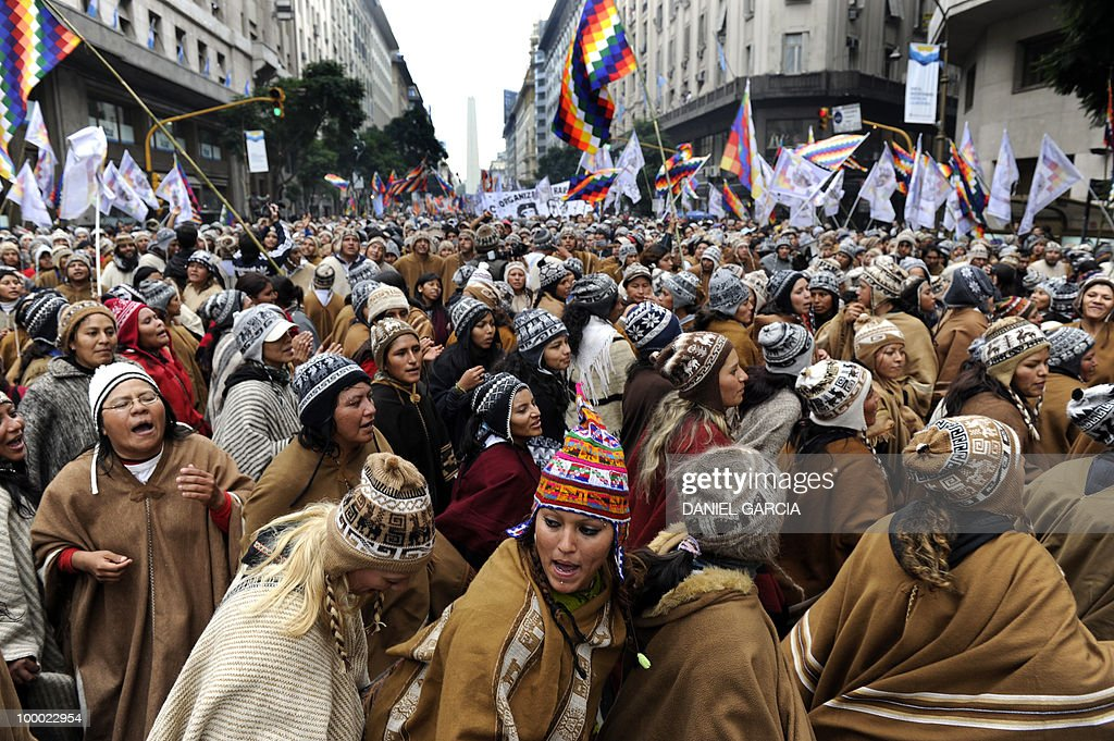 Thousands of demonstrators dance and sing as they participate in the National Indigenous March that arrived in the Plaza de Mayo in Buenos Aires after traveling some 2,000 km across the country, as part of the commemorations for the bicentennial of the Independence and to claim for a multicultural state that respects the rights of native peoples.