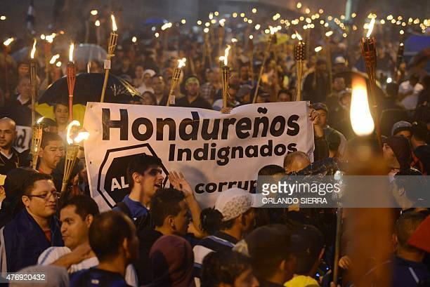 Thousands of demonstrators march toward the US Embassy demanding the resignation of Honduras' President Juan Orlando Hernandez accused of corruption...