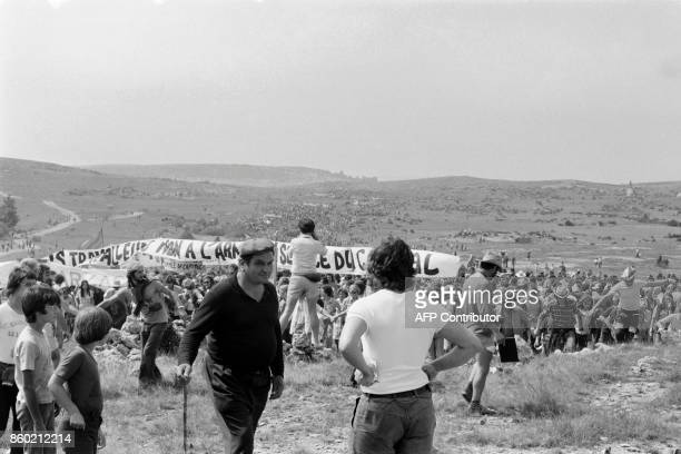 Thousands of demonstrators protest against a military camp extension at the Larzac plateau in the south of France on August 27 1973 / AFP PHOTO /