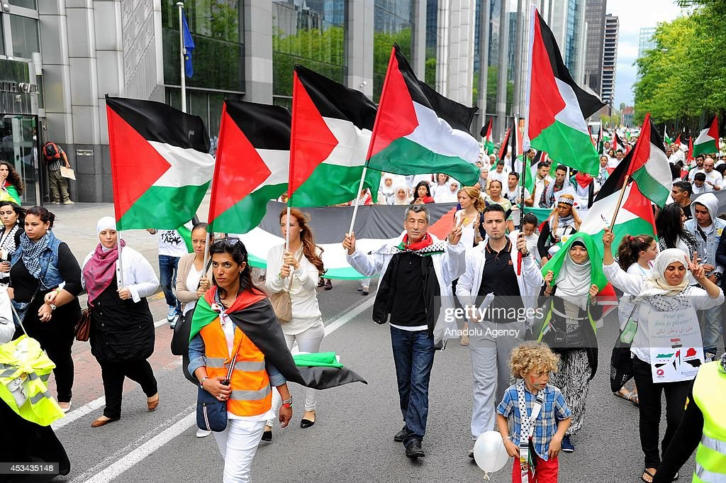 Thousands of demonstrators stage a 'White March for Palestine' to protest the Israel's Gaza attacks on August 10, 2014 in Brussels, Belgium.