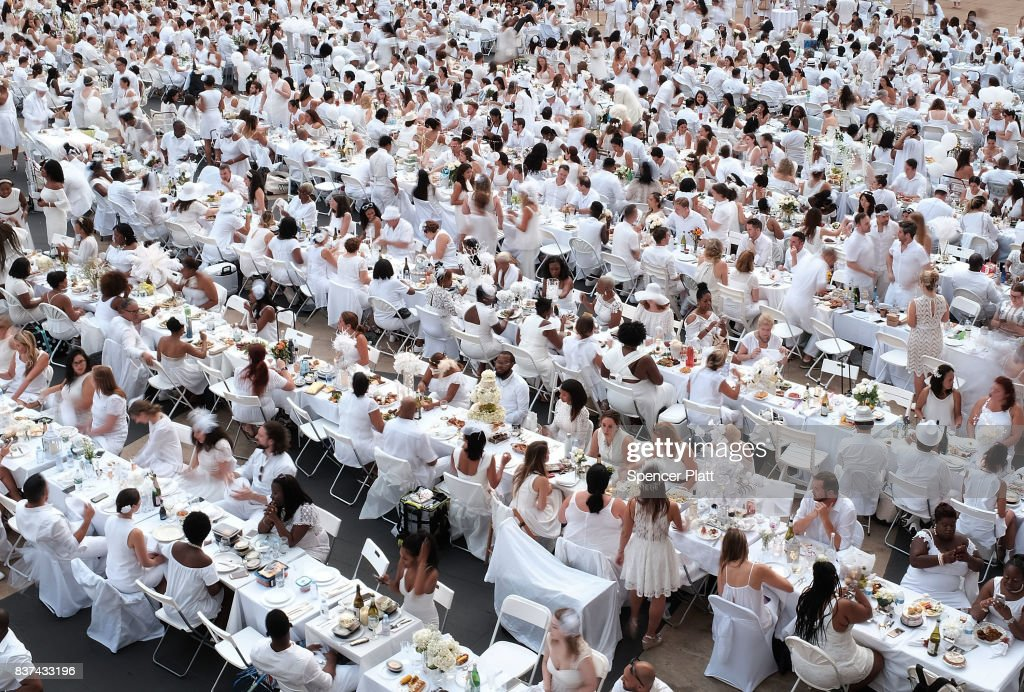 Thousands of diners participate in the annual 'Diner en Blanc' (Dinner in White) at Lincoln Center on August 22, 2017 in New York City. Diner en Blanc began in France nearly 30 years ago. Attendees all must wear white clothing and bring their own picnic food and white tables clothes. It's the second time the event, which is held in cities around the world, has been held at Lincoln Center.