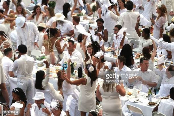 Thousands of diners wave their napkins at the start of the annual 'Diner en Blanc' at Lincoln Center on August 22 2017 in New York City Diner en...