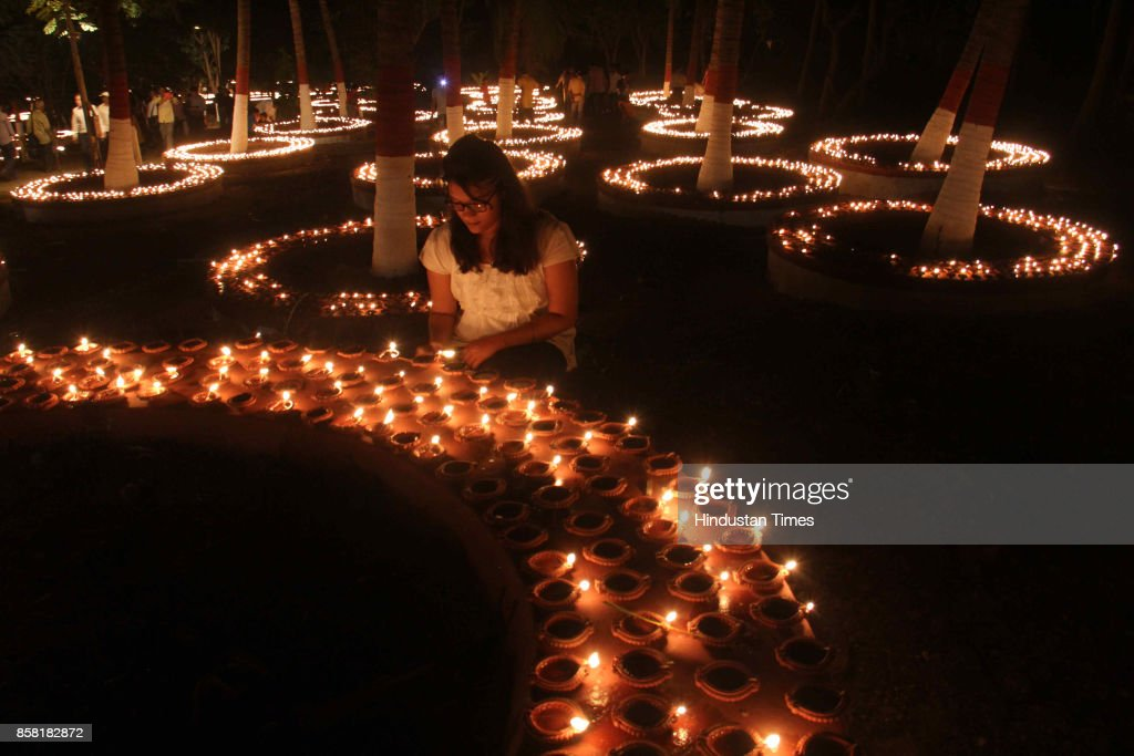 Thousands of Diyas lighten up by devotees during 'Laksha Deepotsav' festival on the occasion of Sharad Purnima at Swami Gagangiri Maharaj Ashram, Manori, Malad, on October 5, 2017 in Mumbai, India. Sharad Purnima is a harvest festival celebrated on the full moon day of the Hindu lunar month of Ashvin, marking the end of the monsoon season. The Kojagari Purnima concerns the observance of the Kojagara Vrata.