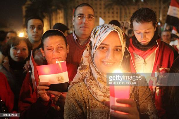 Thousands of Egyptian Muslims and Coptic Christians attend a celebration on New Year's eve in Tahrir Square in Cairo on December 31 as they remember...