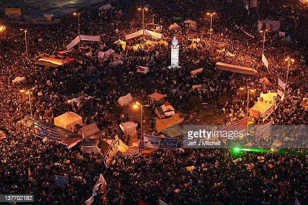 Thousands of Egyptians gather tonight in Tahrir Square to mark the one year anniversary of the revolution on January 25 2012 in Cairo Egypt Tens of...