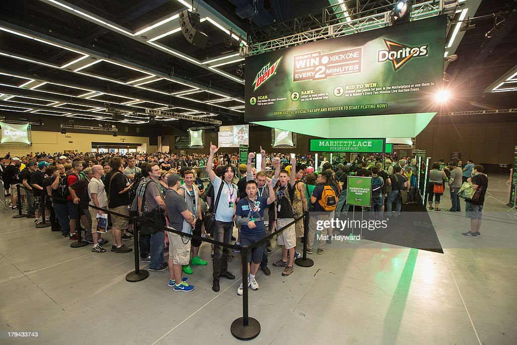 Thousands of fans and gamers get ready to enjoy PAX Prime 2013 and redeem points for tickets for entry into the Live Auction event and exclusive gear at the Mountain Dew® and Doritos® 'Every 2 Minutes' Marketplace on September 1, 2013 in Seattle, Washington.
