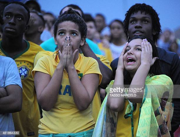Thousands of fans at the FIFA Fan Fest in Rio de Janeiro attend the Brazil 2014 FIFA World Cup semifinal match Brazil vs Germany being held at...