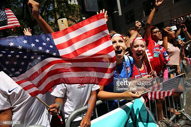 Thousands of fans cheer as the World Cupwinning US women's soccer team make their way up the The Canyon of Heroes along Broadway during a tickertape...