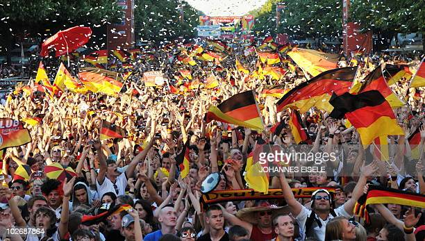 Thousands of fans of the German national football team cheer during the public viewing at the 'Fanmeile' in Berlin on July 7 of the FIFA World Cup...