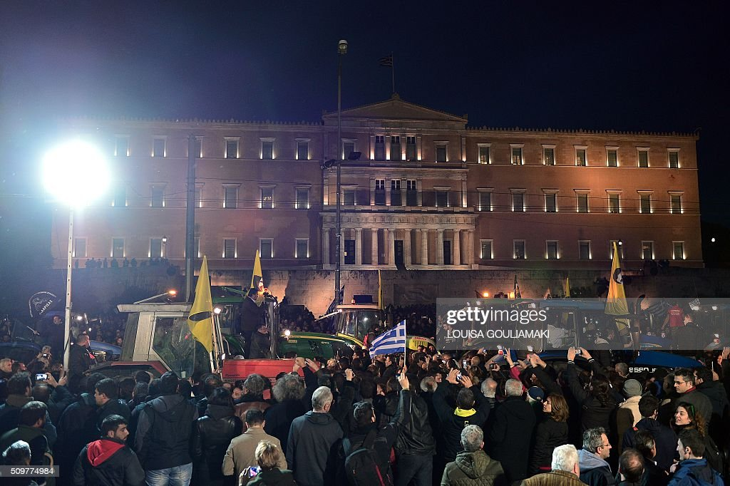 Thousands of farmers and protesters gather in front of the Greek parliament in Athens during a rally against pension reform on February 12, 2016. Fears that Greece will exit the eurozone, a 'Grexit', could revive if Greek authorities do not come up with 'credible' reforms, notably on pensions, a senior IMF official said on February 11, 2016. / AFP / LOUISA GOULIAMAKI
