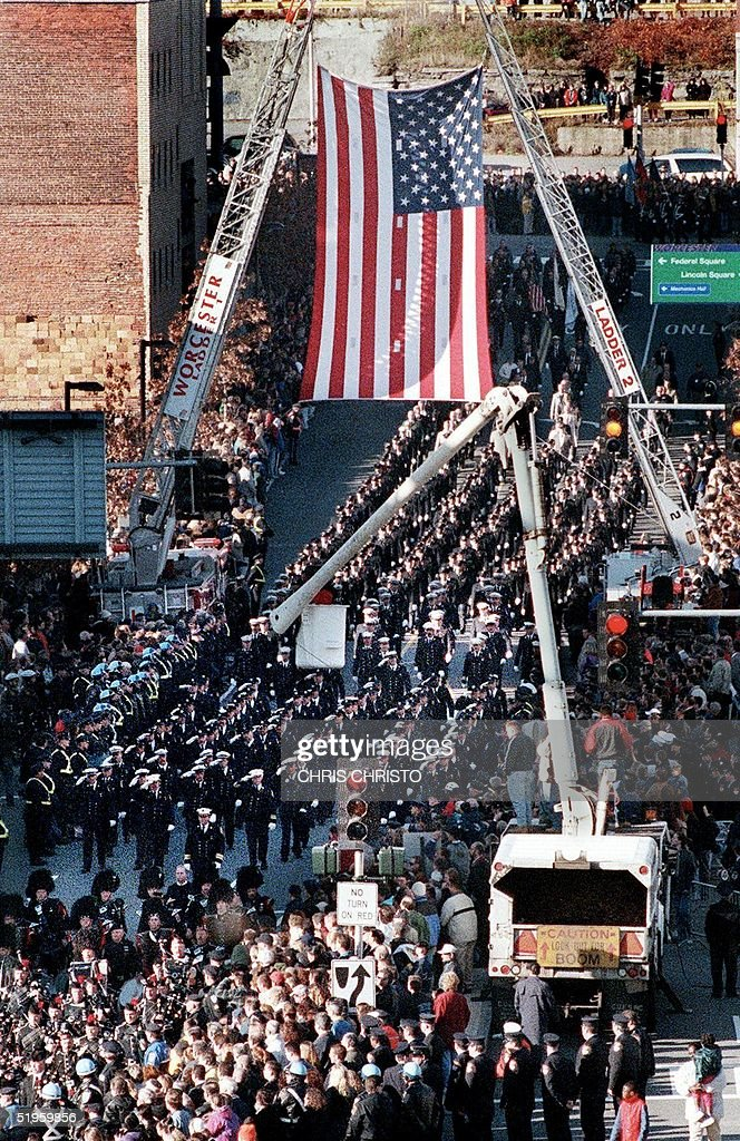 Thousands of firefighters from around the United States march in a procession in downtown Worchester MA 09 December 1999 honoring the six Worchester...